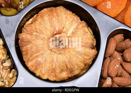 Dry Organic Pineapple Slices Ready to Eat Dried pineapple dried fruit. - Stock Photo