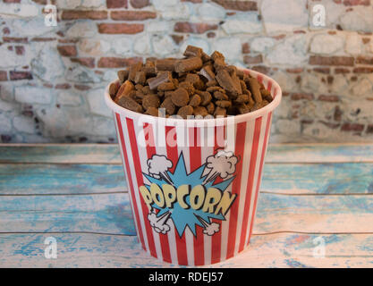 dog prizes in a container of popcorn - Stock Photo