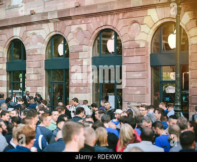 STRASBOURG, FRANCE - SEP, 19 2014: Apple Store with customers waiting in line to buy the latest iPhone iPad Apple Watch and notebook - Stock Photo