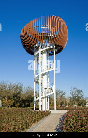 Modern architecture watchtower in a park. Chinese municipal governments want to embrace a new sustainable model of urban planning with green areas. - Stock Photo