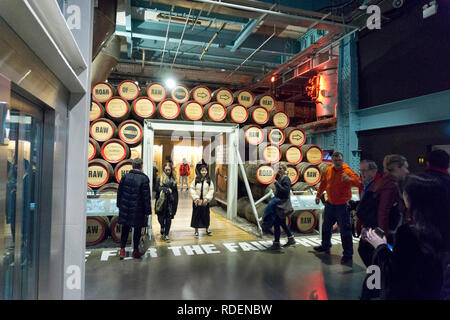 Old wooden barrels of Guinness on display at the Guinness Storehouse Brewery in Dublin, Ireland, 15 Jan 2019. - Stock Photo