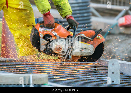 Man using Angle Grinder pn Blackpool tramway extension, UK - Stock Photo