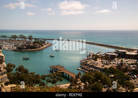 View of beautiful marina from above. There is a long stone breakwater. - Stock Photo
