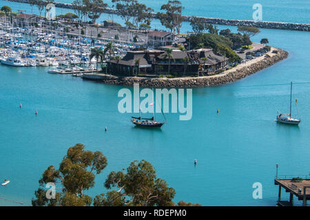 View of beautiful marina from above with large beautiful sailboat in beautiful blue lagoon - Stock Photo