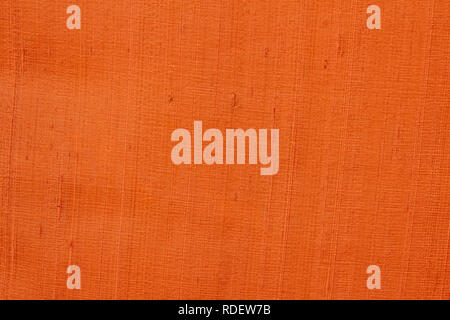 Close up of a woolen fabric of orange-brown color. Abstract canvas background, empty template. - Stock Photo