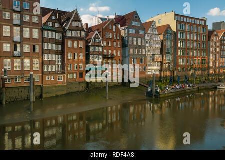 The oldest and historic brick houses on Nikolaifleet in Hamburg - Stock Photo