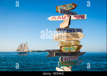 KEY WEST, FLORIDA, USA - JANUARY 13, 2019: A rustic wooden direction sign topped with the message #selfiemostpoint stands on Sunset Pier at Mallory Sq - Stock Photo