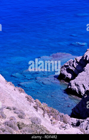 clear blue water and some rock on Karpathos island - Stock Photo