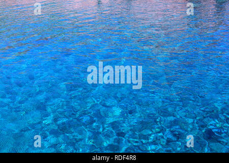 clear blue water on Karpathos island - Stock Photo