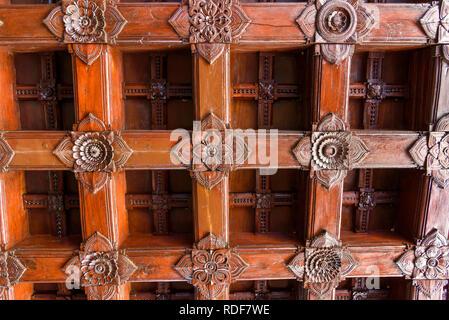 Ornate wooden ceiling, Padmanabhapuram Palace, typical Keralan architecture, Tamil Nadu, India - Stock Photo