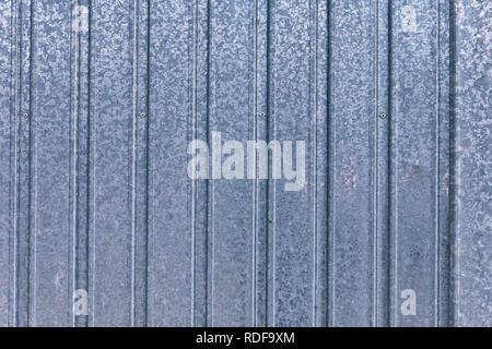 Background or texture of galvanized sheet metal of a garage door. - Stock Photo