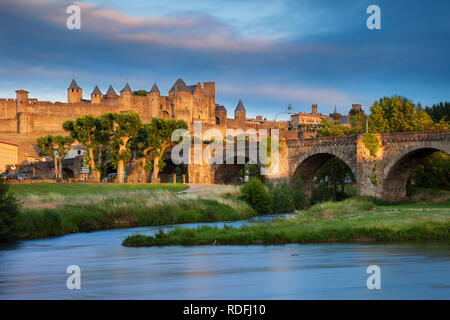 Setting sunlight over medieval town of Carcassonne and River Aude, Occitanie, France - Stock Photo