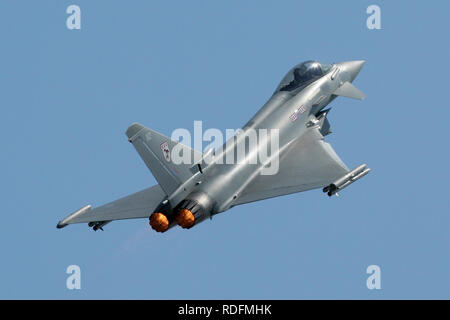 RAF Typhoon F2 from 29 Squadron climbing out with afterburner during the 2006 RAF Waddington air show. - Stock Photo