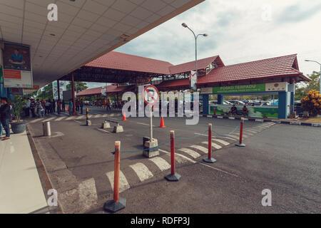 Manado, Indonesia - August 03 2015: front of airport passenger terminal on Sam Ratulangi International Airport - Stock Photo