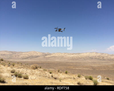 DJI Mavic Pro drone hovering over desert landscape ( camera drone ) - California USA - Stock Photo