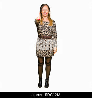 Beautiful middle age woman wearing leopard animal print dress Pointing with finger up and angry expression - Stock Photo