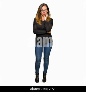 Beautiful middle age woman wearing glasses thinking looking tired and bored with depression problems with crossed arms. - Stock Photo
