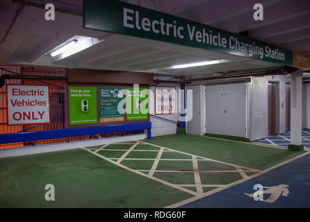 Electric Vehicle Charging Station, in city centre car park, UK - Stock Photo