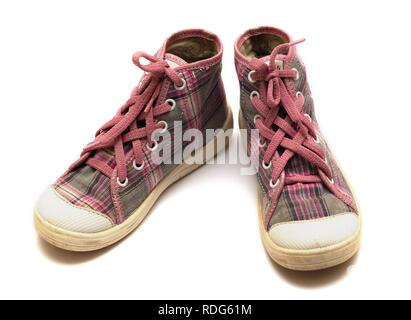 pink girls tartan gumshoes isolated on a white - Stock Photo