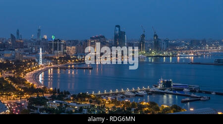 Evening in Azerbaijan, multiple modern skyscrapers over the Baku's bay - Stock Photo