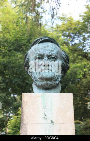 Richard Wagner bust in the park in front of the Bayreuth Festspielhaus or Bayreuth Festival Theatre, Bayreuth, Upper Franconia - Stock Photo