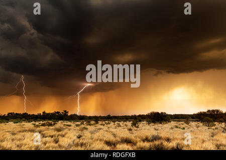 Thunderstorm and lightning in the australian desert. - Stock Photo