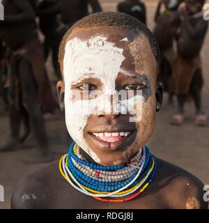 Karo boy with facial paintings and colorful necklaces, portrait, Omo river valley, Southern Ethiopia, Africa - Stock Photo