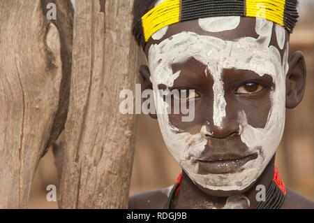 Karo boy with facial paintings, portrait, Omo river valley, Southern Ethiopia, Africa - Stock Photo