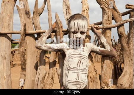 Karo boy with facial and body paintings, Omo river valley, Southern Ethiopia, Africa - Stock Photo