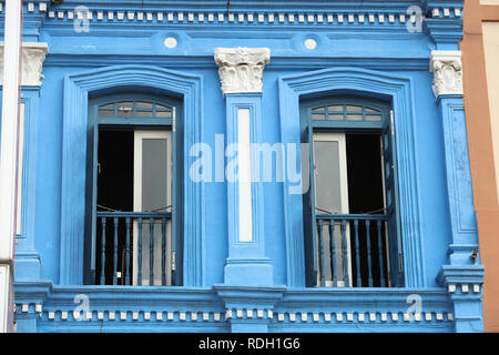 Colourful blue painted house in Chinatown Singapore, one of the many older style traditional buildings in the city, attracting tourists and visitors. - Stock Photo