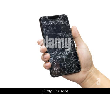 Man holding a black mobile phone and screen broken isolated on a white background. - Stock Photo
