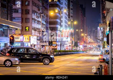 Hong Kong, Hong Kong - October 16, 2018: People are traveling in the night street of Nathan Road. - Stock Photo