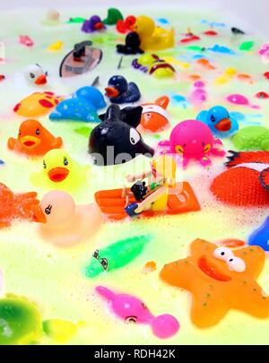Various colourful water toys with bath foam - Stock Photo