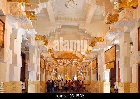 Buddha statue at the Buddhist shrine of Sri Dalada Maligawa, Temple of the Tooth, repository of the tooth relic of Buddha, Kandy - Stock Photo