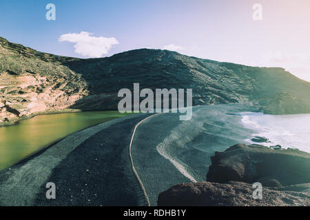 Sunset landscape of Charco de los Clicos (Green Lagoon) Lago Verde near El Golfo in Yaiza, Las palmas, Lanzarote, Spain - Stock Photo