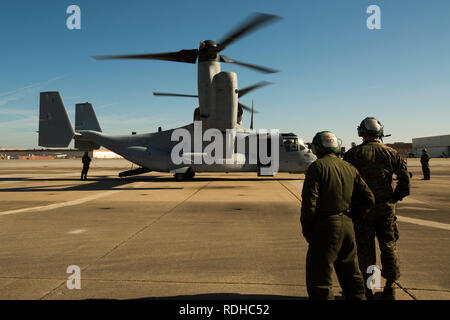 NAVAL STATION NORFOLK, NORFOLK, Va. —Marines with Marine Medium Tiltrotor Squadron 774 oversee the functions check of an MV-22 Osprey before a familiarization flight Jan. 16, 2018, at Naval Station Norfolk in Norfolk, Virginia. The flight afforded U.S. Marine Forces Command Marines and Sailors the opportunity to experience what it is like to fly in an osprey and strengthen unit morale between VMM-774 and MARFORCOM. (U.S. Marine Corps photo by Cpl. Danielle Prentice/ Released) - Stock Photo