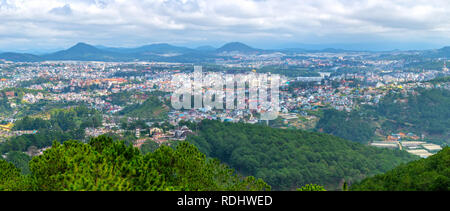 The panorama of Da Lat city is seen from above with the intertwined house architecture - Stock Photo