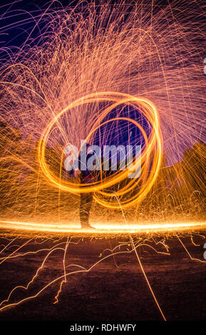 Steel wool photograph at night, long exposure photography workshop - Stock Photo