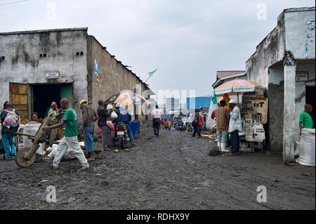 The roads in Goma, North Kivu, Democratic Republic of Congo are muddy, congested, and chaotic. - Stock Photo