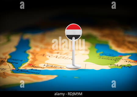 Yemeni marked with a flag on the map - Stock Photo