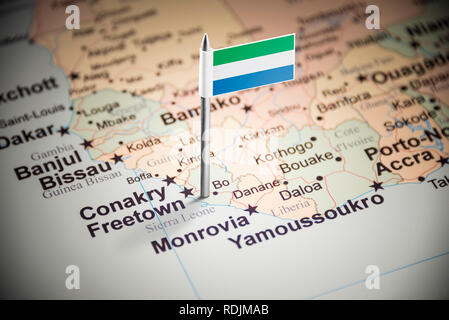 Sierra Leone marked with a flag on the map - Stock Photo