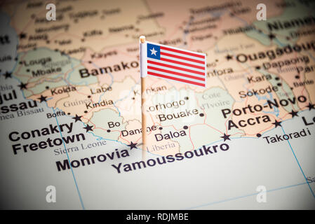 Liberia marked with a flag on the map - Stock Photo