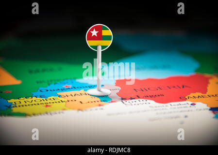 togo marked with a flag on the map - Stock Photo