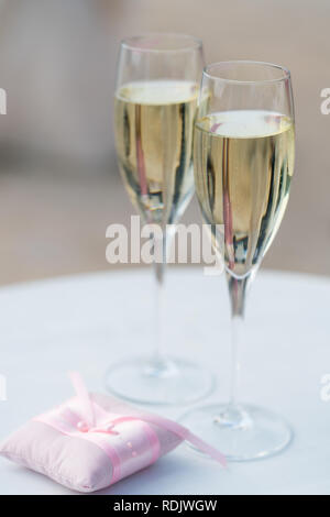 two glasses of champagne for the newlyweds on the table - Stock Photo