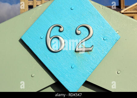 Number 62 sign in wooden hut Brighton, England, close-up - Stock Photo