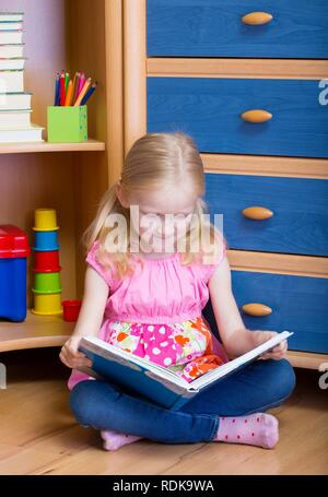 girl reads book in your room - Stock Photo