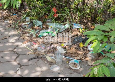 Vientiane, Laos - August 9, 2018: Plastic garbage on the sidewalk in the center of Vientiane City. - Stock Photo