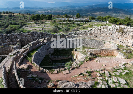 Circular graveyard at the archaeological site of Mycenae in Peloponnese, Greece - Stock Photo