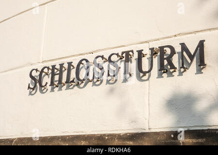 Placard in German with word 'Schlossturm', that means 'castle tower'. This ancient building is located in Dusseldorf, Germany - Stock Photo