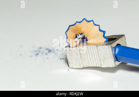 Sharpener, Blue Wooden Pencil And Pencil Shavings Isolated On White Background. Macro Photography - Stock Photo